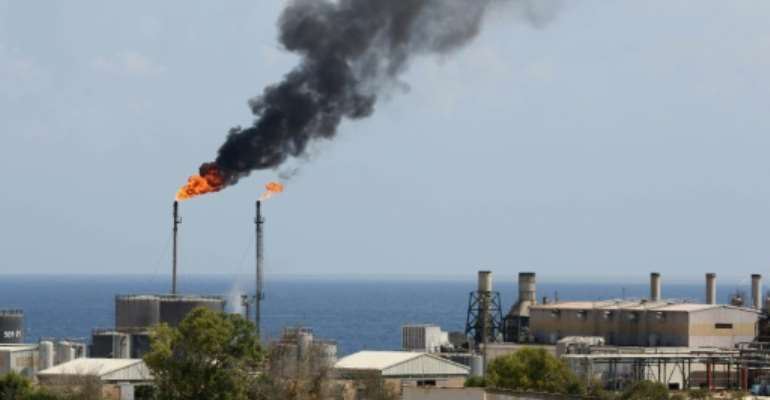 In this file photo taken on August 22, 2013, a general view shows the Libyan oil installation at Zawiya.  By Mahmud TURKIA (AFP/File)