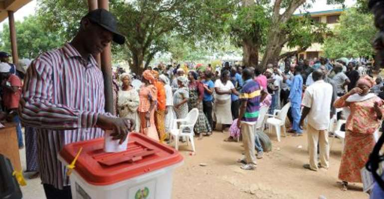 A man casts his vote at the Epe district of Lagos, Nigeria, on April 11, 2015.  By Pius Utomi Ekpei (AFP/File)