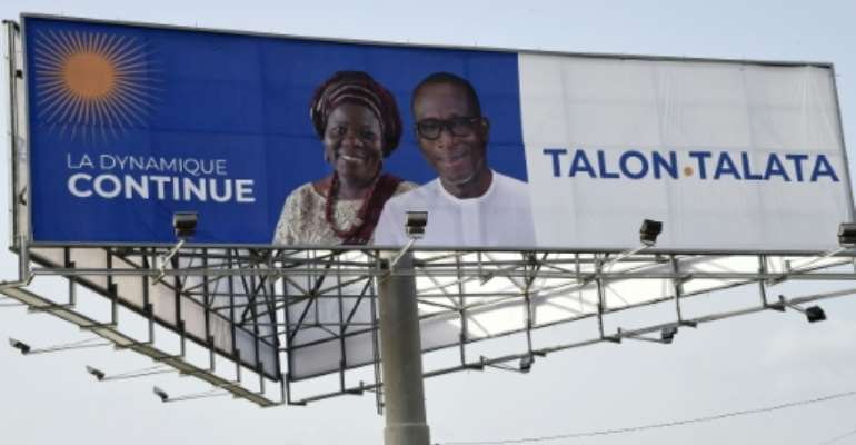 Incumbent President Patrice Talon (R) is expected to win reelection in Benin Sunday faced with a hobbled opposition.  By PIUS UTOMI EKPEI (AFP/File)