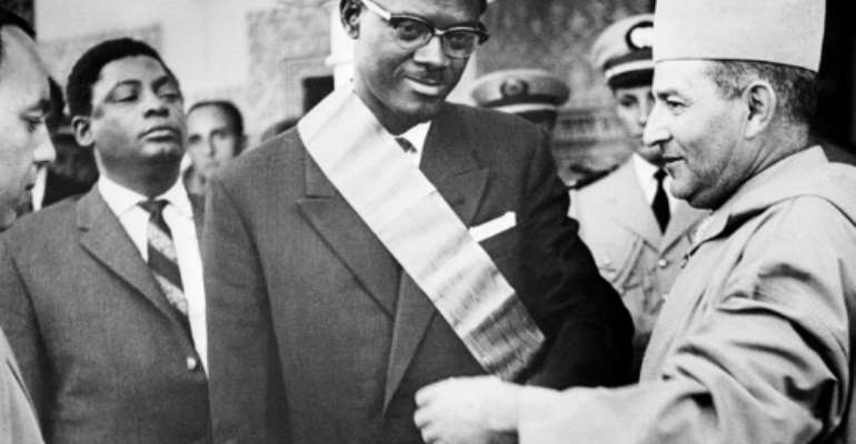 Independence leader Patrice Lumumba, shown here in 1960 in the center, was shot by Belgian-backed rebel troops and his body dissolved in acid in 1961.  By - (AFP/File)