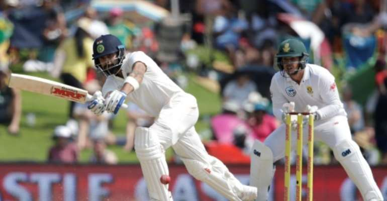 India captain Virat Kohli plays a shot during the second day of the second Test against South Africa at Supersport cricket ground in Centurion, South Africa on January 14, 2018.  By Gianluigi GUERCIA (AFP)