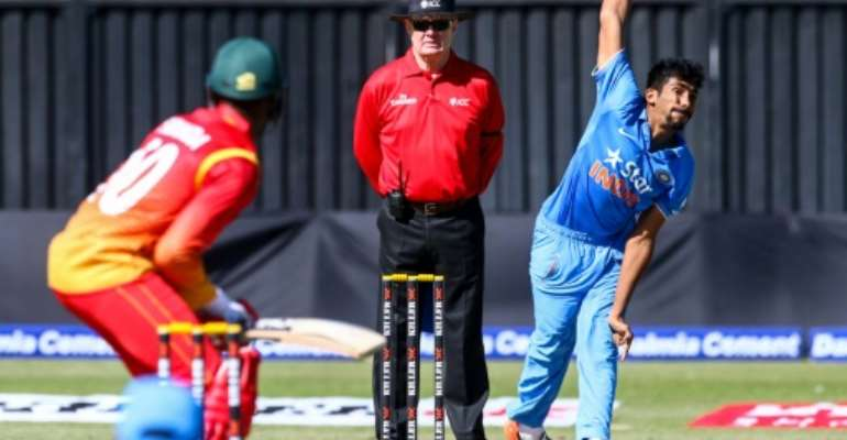 India bowler Jasprit Bhumra (right) bowls during the first one-day interational (ODI) matches at the Harare Sports Club in Harare on June 11, 2016.  By Jekesai Njikizana (AFP)