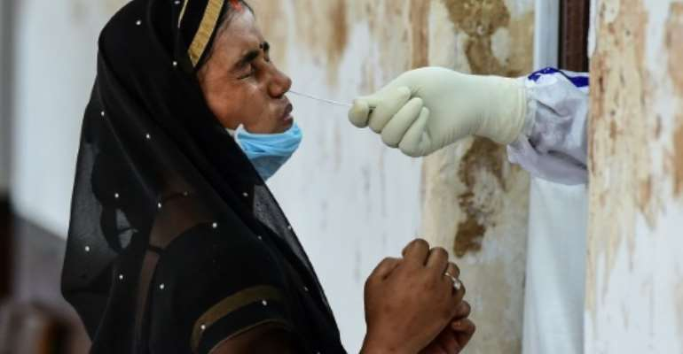 India has set a global daily record with 78,761 new coronavirus infections.  By SANJAY KANOJIA (AFP/File)