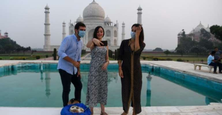 India opened its famed Taj Mahal on Monday, as authorities pressed ahead with a reopening of the battered economy despite surging coronavirus cases.  By Sajjad HUSSAIN (AFP)