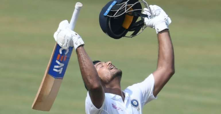 Indian cricketer Mayank Agarwal celebrates scoring 200 runs during the second day's play of the first Test match against South Africa.  By NOAH SEELAM (AFP)