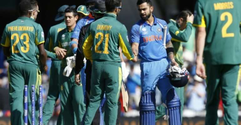 India's captain Virat Kohli (C-R) shakes hands with South Africa's JP Duminy after their ICC Champions Trophy match, at The Oval in London, on June 11, 2017.  By Ian KINGTON (AFP)