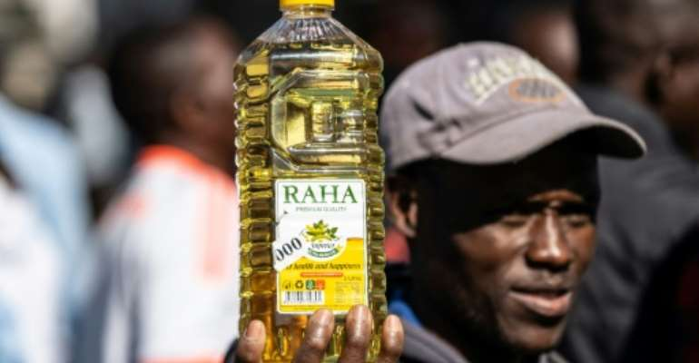 Inflation anger: A protester holds a bottle of cooking oil during a demonstration in Harare last August over the cost of food.  By Zinyange Auntony (AFP)