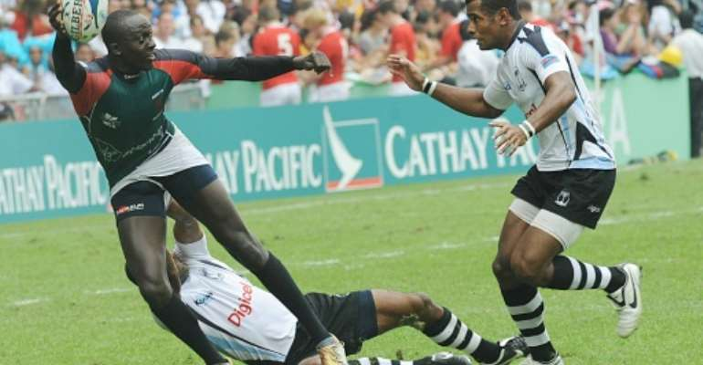 Innocent Simiyu (left), pictured during the 2008 Hong Kong Sevens, has been reappointed Kenya 7s coach.  By MIKE CLARKE (AFP/File)