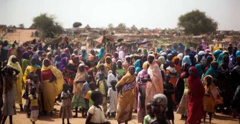 A handout picture released by the United Nations-African Union Mission in Darfur (UNAMID) shows displaced women and children in the Zam Zam camp in North Darfur, on April 3, 2014.  By Albert Gonzalez Farran (UNAMID/AFP/File)