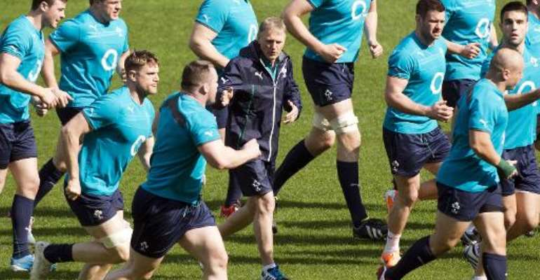 Ireland's head coach Joe Schmidt (C) warms up with his players during captain's run, at Stade de France stadium in Saint-Denis, near Paris, on March 14, 2014.  By Lionel Bonaventure (AFP/File)