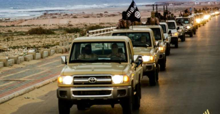 An image from Islamist media outlet Welayat Tarablos on February 18, 2015 allegedly shows members of the Islamic State group parading in a street in Libya's coastal city of Sirte.  By  (Welayat Tarablos/AFP/File)