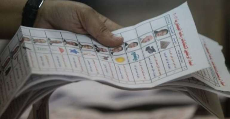 An Egyptian election official counts ballots at a polling station in Cairo.  By Khaled Desouki (AFP/File)