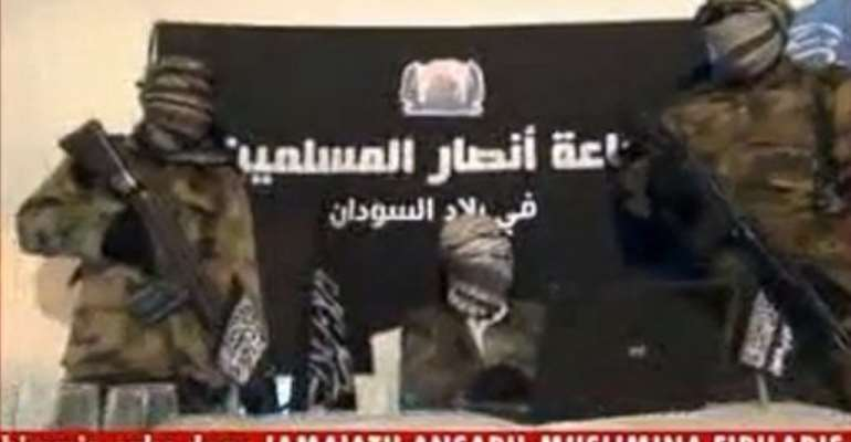 An image from a video released by Ansaru reportedly shows unidentified members of the group in November 2012.  By  (Ansaru/AFP/File)