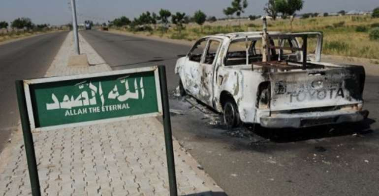 A burnt police truck on the side of a deserted road in Damaturu, Yobe State.  By Pius Utomi Ekpei (AFP/File)