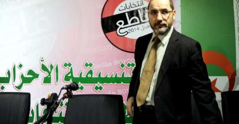 The president of the Movement for the Society of Peace (MSP), the Algerian branch of the Muslim Brotherhood, Abderrezak Mokri arrives for a press conference on April 11, 2014 in the capital Algiers.  By Farouk Batiche (AFP)
