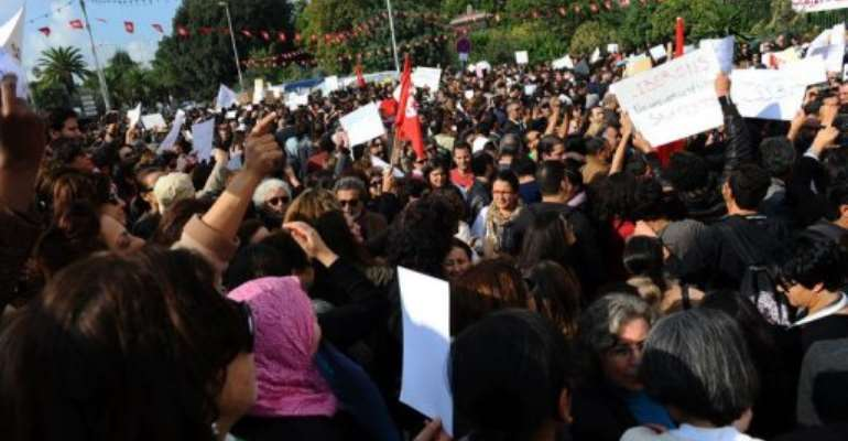 Tunisian people demonstrate outside the Constituent Assembly in Tunis.  By Fethi Belaid (AFP/File)
