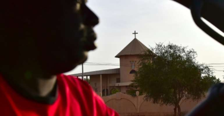 It was the first attack on a church in Burkina Faso since the jihadist violence began.  By ISSOUF SANOGO (AFP)