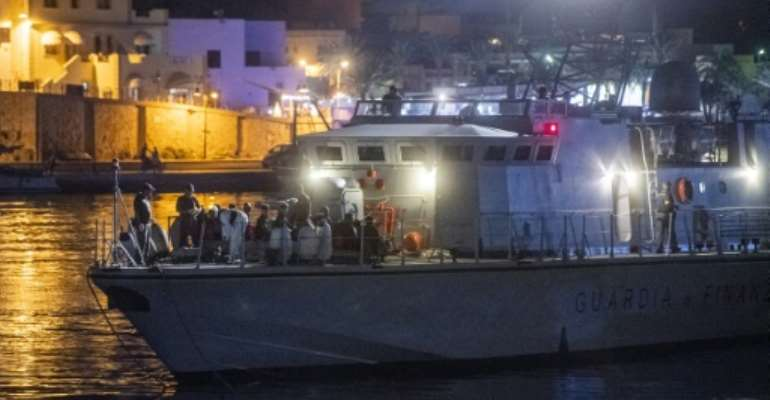 Italian authorities identified and carried out medical checks on the African migrants after they disembarked overnight on southern island Lampedusa after more than six days at sea.  By Alessandro SERRANO (AFP)