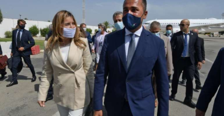 Italian Foreign Minister Luigi Di Maio (R) is welcomed on his arrival in Tunis by Tunisian Secretary of State for Foreign Affairs Salma Ennaiefer.  By Fethi Belaid (AFP)