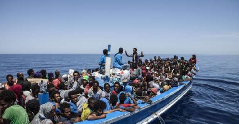 The Italian coastguard says it has rescued nearly 6,000 people in recent days as they try to cross the Mediterranean on rickety boats.  By Jason Florio (Migrant Offshore Aid Station/AFP)