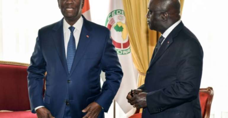 Ivorian President Alassane Ouattara, left, with the then foreign minister Marcel Amon-Tanoh, pictured in October 2018. Amon-Tanoh has declared his bid to succeed Ouattara as head of state.  By ISSOUF SANOGO (AFP)