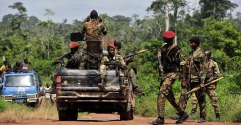 Ivory Coast soldiers patrol near the border with Liberia in June.  By Issouf Sanogo (AFP/File)