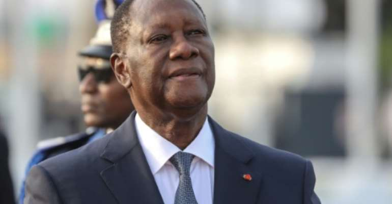 Ivory Coast President Alassane Ouattara and his supporters argue that a 2016 constitutional tweak allows him to seek a third.  By Ludovic MARIN (AFP/File)