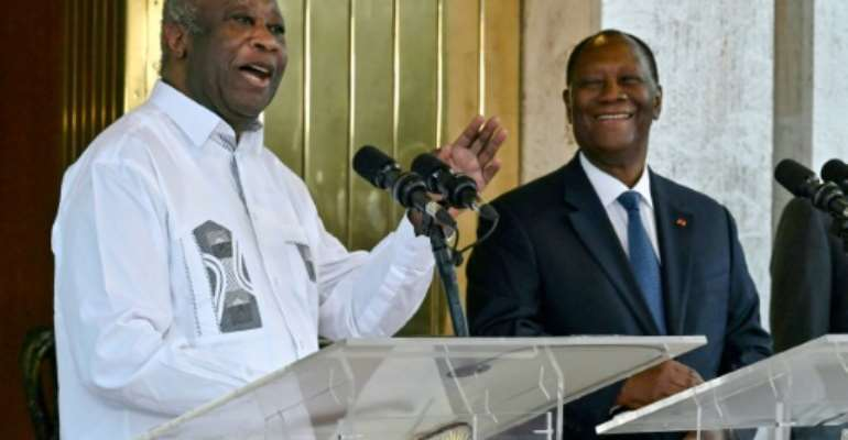 Ivory Coast President Alassane Ouattara (R) and his predecessor and former rival Laurent Gbagbo (L) met for the first time since the crisis.  By Issouf SANOGO (AFP)