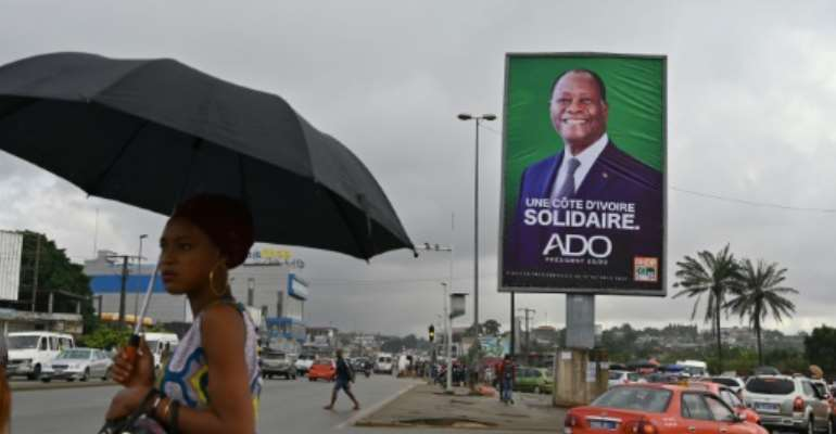 Ivory Coast's President Alassane Ouattara, seen here in a campaign poster, is running for a third term in defiance of a constitutional limit.  By Issouf SANOGO (AFP/File)