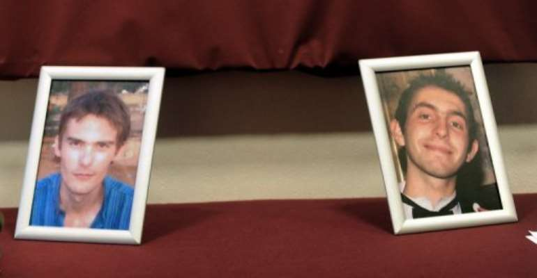 Portraits of Vincent Delory and Antoine de Leocour (L), the two French men killed while held by militants in Niger.  By Denis Charlet (AFP/File)