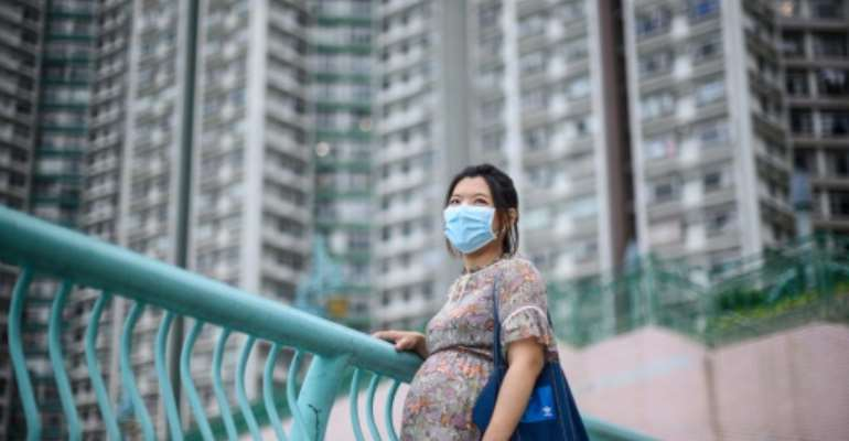 Jamie Chui has been a virtual prisoner in her Hong Kong home for most of her pregnancy, trapped intially by violent pro-democracy protests and tear gas, and then by the coronavirus -- she now faces giving birth alone.  By Anthony WALLACE (AFP)