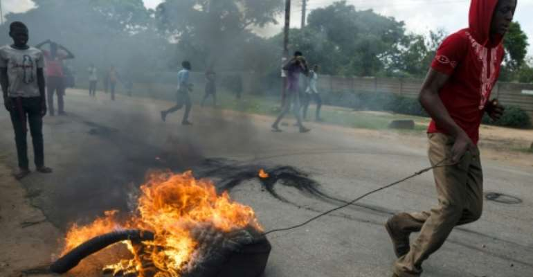 January 14 2019: Protests erupt in Harare over a fuel price hike.  By Jekesai NJIKIZANA (AFP)