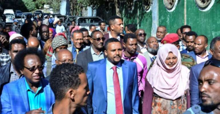 Jawar Mohammed, centre, among supporters who had gathered outside his home in Addis on Thursday. He has accused security forces of trying to orchestrate an attack against him.  By STRINGER (AFP)