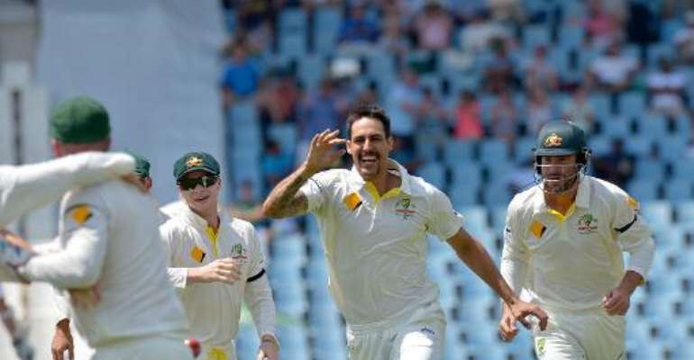Mitchell Johnson (C) celebrates after bowling out South Africa's Graeme Smith in the first test match between South Africa and Australia at SuperSport Park in Centurion on February 13, 2014.  By Alexander Joe (AFP)