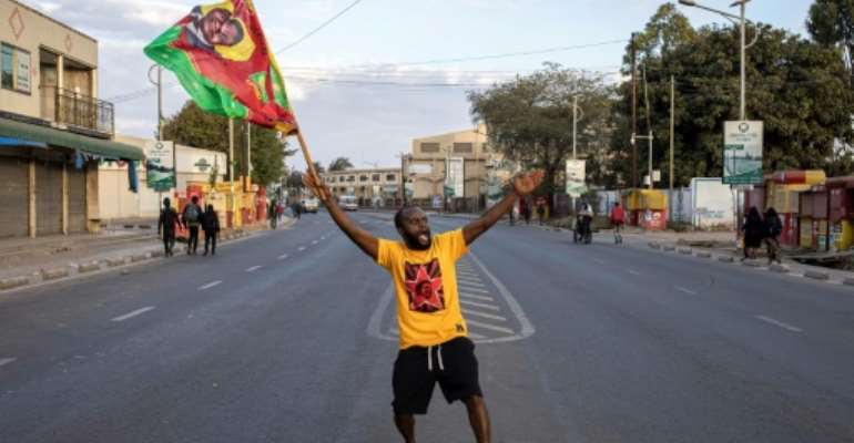 Joy: A Hichilema supporter celebrates Zambia's election results.  By Patrick Meinhardt (AFP)