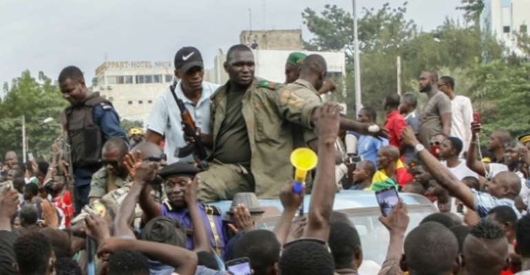 Jubilant crowds cheered the rebels as they arrived in central Bamkako on Tuesday.  By STRINGER (AFP)