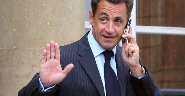 File picture taken on August 27, 2007 shows French President Nicolas Sarkozy talking on his mobile at the Elysee Palace in Paris.  By Thomas Coex (AFP/File)
