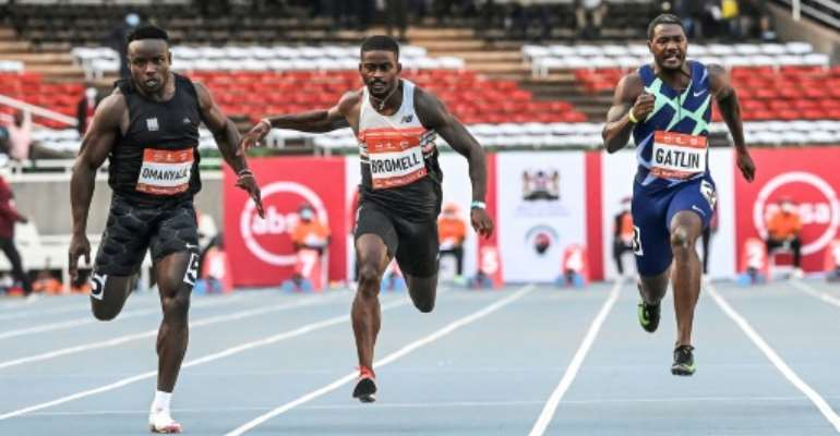 Justin Gatlin (right) could only finish third behind Trayvon Bromell (centre) and Ferdinand Omanyala (left) in the men's 100m race in Nairobi on Saturday.  By Simon MAINA (AFP)