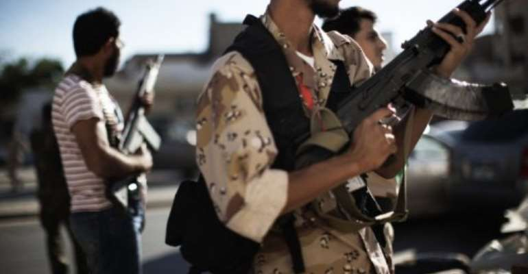 Libyan National Transitional Council fighters deploy in Tripoli.  By Marco Longari (AFP/File)