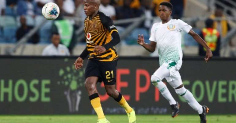 Kaizer Chiefs star Lebogang Manyama (L) is pursued by a Bloemfontein Celtic opponent during a South African Premiership match this season.  By Anesh DEBIKY (AFP)