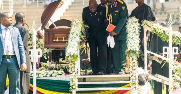 Kaunda being helped down steps in September 2019 at the funeral of Zimbabwean former president Robert Mugabe.  By Jekesai NJIKIZANA (AFP/File)