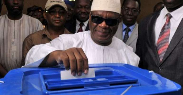 Ibrahim Boubacar Keita casts his vote at the polling station in Bamako on August 11, 2013.  By Issouf Sanogo (AFP/File)