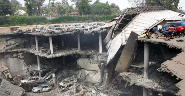 A handout picture from the Kenyan presidency shows a destroyed section of the Westgate mall in Nairobi on September 26, 2013.  By  (KENYAN PRESIDENCY/AFP/File)