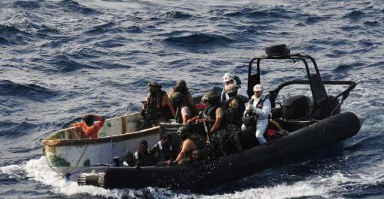 This handout picture released by the EU Navfor on January 13, 2012 shows members of the ESPS Patino escorting suspected pirates to their ship.  By  (EU NAVFOR/AFP/File)