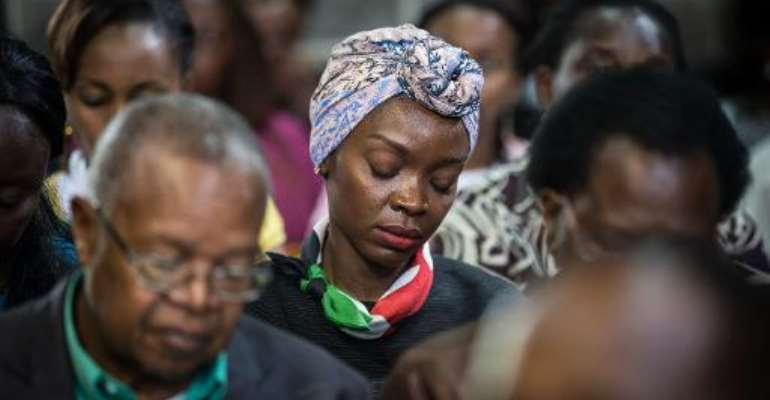 Hundreds gather for an Easter service at the All Saints' Cathedral in Nairobi on April 5, 2015, mourning one of the country's worst ever massacres.  By Nichole Sobecki (AFP)