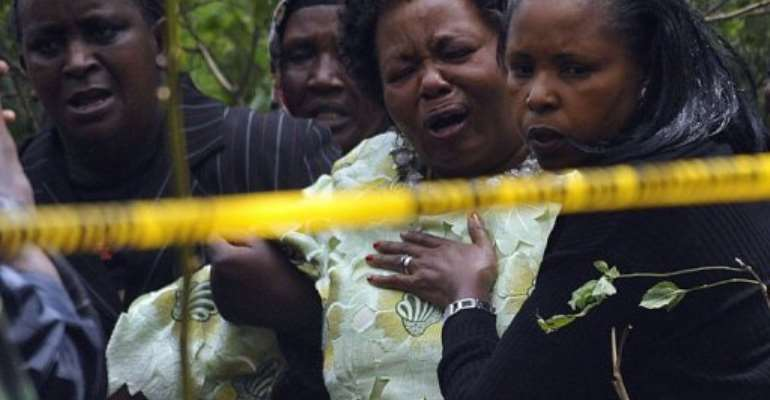 Relatives react as they arrive at the site of a police helicopter crash in the Ngong hills outside Nairobi.  By Simon Maina (AFP)