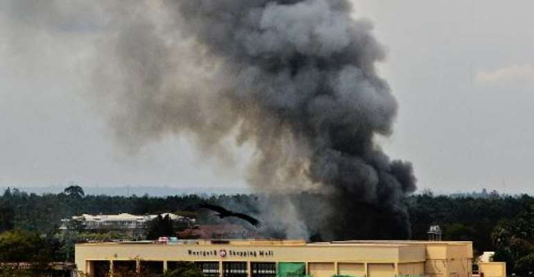 Smoke rises from the Westgate mall in Nairobi on September 23, 2013.  By Carl de Souza (AFP/File)