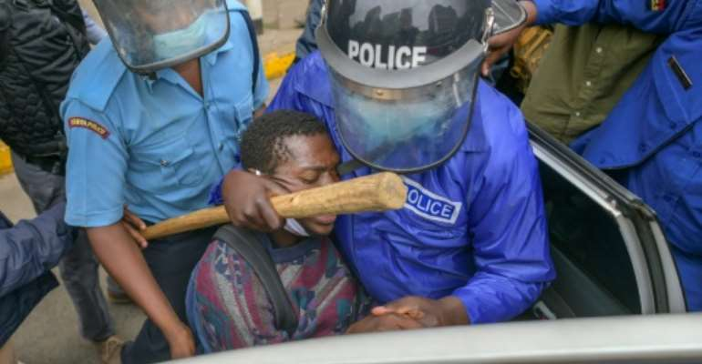 Kenyan police have often been accused of brutality in the past, but charges are rare.  By TONY KARUMBA (AFP/File)