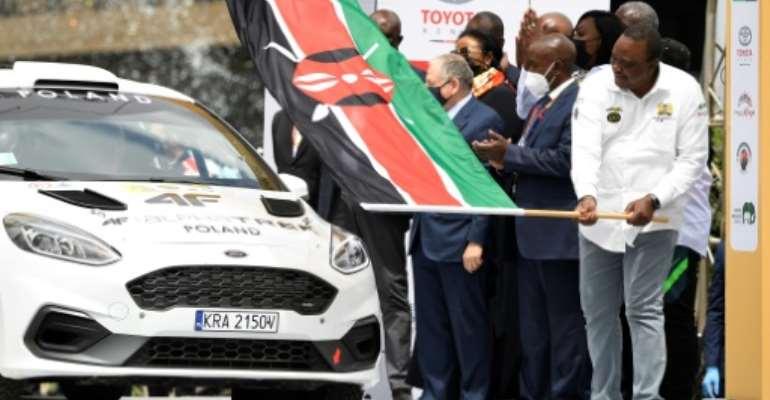 Kenyan President Uhuru Kenyatta (R) started the rally.  By TONY KARUMBA (AFP)