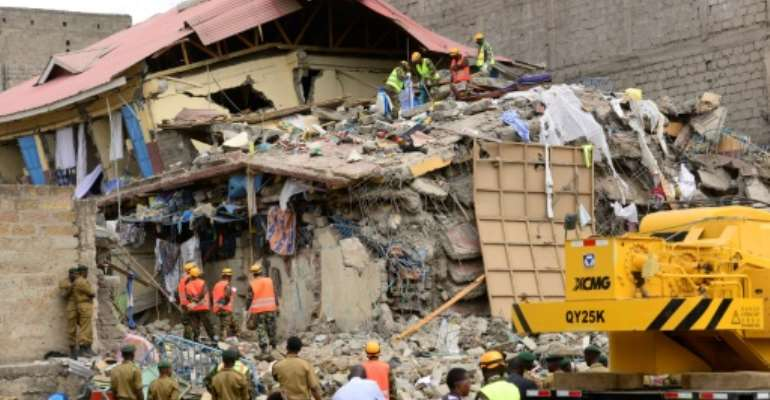 Kenyan rescue workers believe there may be people still trapped under the rubble of the seven-storey building which collapsed overnight in a sprawling slum near Nairobi's airport.  By JOHN MUCHUCHA (AFP)